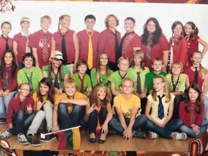 2009 metais dėl trispalvės aprangos 6b klasė laimėjo klasės nuotraukos prizą